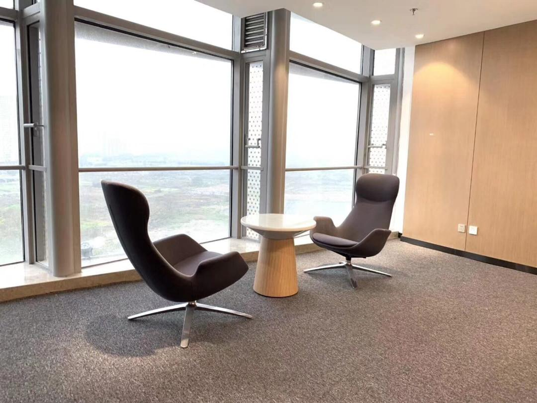 Collaborative Office Seating. Two leather chairs shown in black and taupe.